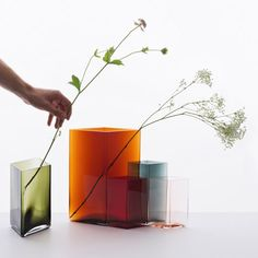 Ruutu vases by French Bouroullec brothers for Iittala, Finland.  Diamond shape in minimal color meant to overlap together.
