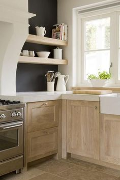 Love the natural wood cabinets and great paint color in the kitchen!