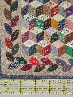 Miniature Quilt: Tumbling Block  Tumbling Blocks would make a cool looking border.