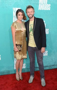 Nikki Reed and Paul MacDonald photographed on the red carpet at the 2012 MTV Movie Awards in Los Angeles.