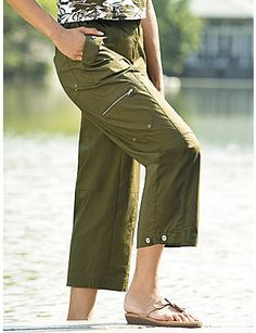 """Relaxed fit, with button-and-zip fly and partial elastic waist. Zip cargo pockets, button-and-tab hems and grommet detailing. Woven of 97% cotton/3% spandex. Machine wash. Imported. Inseam: 24"""". sonsi.com"""