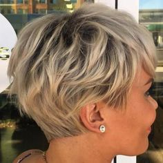 Layered Ash Blonde Pixie;  enough length for shaggy appearance, blunt straight line nape, angled sideburns