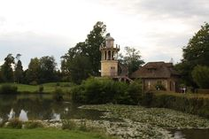 Marie Antoinette's Hamlet.  While the Chateau de Versailles is the grand palace where Louis XVI held court, Queen Marie Antoinette had the Hameau (Hamlet) , a village the King created for her. http://www.francetraveltips.com/marie-antoinettes-petit-trianon-hamlet/