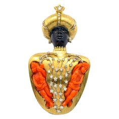 Large & Unique NARDI Carved Coral Blackamoor | From a unique collection of vintage brooches at http://www.1stdibs.com/jewelry/brooches/brooches/