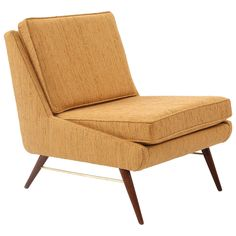 Paul McCobb Walnut Brass and Upholstered Lounge Chair | From a unique collection of antique and modern lounge chairs at https://www.1stdibs.com/furniture/seating/lounge-chairs/