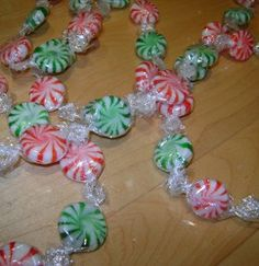 Get out your hot glue gun and get crackin' on this simple Christmas craft today, there's no reason to wait! Make use of your bags of red and green peppermints with a fun DIY garland idea. The Christmas Candy Garland is a super-simple Christmas craft. Candy Land Christmas, Merry Christmas, Easy Christmas Crafts, Christmas Tree Themes, Simple Christmas, Winter Christmas, All Things Christmas, Christmas Ornaments, Christmas Ideas