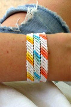 Summer Bracelets Bright summer bracelets that make your tan PoP! Choose your favorite colors to make a bracelet stack at Bright summer bracelets that make your tan PoP! Choose your favorite colors to make a bracelet stack at Yarn Bracelets, Diy Bracelets Easy, Embroidery Bracelets, Summer Bracelets, Bracelet Crafts, String Bracelets, Friend Bracelets, Homemade Bracelets, Leather Bracelets