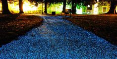 A glow-in-the-dark product that can be coated on pavements to provide ambient light at night