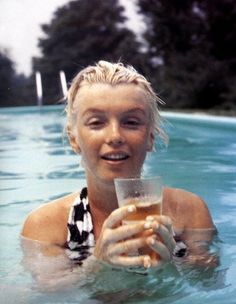 The Real Norma Jean Mortensen Baker in a pool in Connecticut 1955