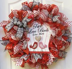 Share the love with this Valentines Day wreath! This wreath is handcrafted with three different types of red and white deco mesh ribbon loops.