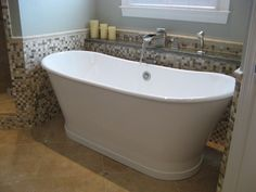 This deep free-standing soaker tub fills in style with our Brizo Vesi Channel Tub Faucet.