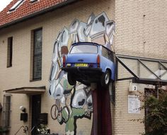"a German car ""Trabant"" plugged into the wall"
