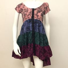 Betsey Johnson Floral Print Hi-Lo Dress Betsey Johnson tiered floral print hi-lo dress.Buttons down the front measure 23 inches. Back center line measures 34.5 inches Betsey Johnson Dresses High Low