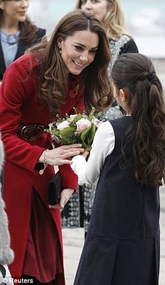 The Duchess is presented with a bouquet of flowers