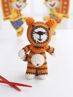 Free Pattern - Ring in the 'Year of the Tiger' with this sweet amigurumi tiger with orange and black stripes. #crochet