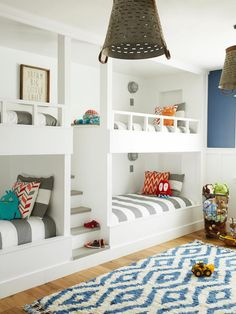 Two bedrooms were combined to create this playroom and sleeping spot for Branson, Asher, and Cannon (baby Easton will stay in his own nursery until he graduates to a bunk bed). Christopher and his dad built the ultra-sturdy bunks. The pendants are made from vintage metal baskets, and the fluffy rug is from Rugs USA.