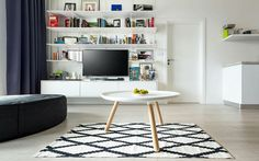 Interior design with Scandinavian elements and a collection of pop art.  Realization of interior_ living room_ scandinavian elements_ pop art _ table tablo_ Normann Copenhagen_ large table white