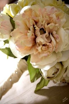 What better to accompany a blushing bride down the aisle than this blush pink bouquet hand-tied and wrapped in satin and pearls.