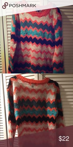 Aqua Turquoise & Orange Chunky Knit Sweater Size L Aqua Turquoise & Orange Chunky Knit Sweater Size L  • 55% wool • 30% acrylic • 15% mohair  Some pulls on fabric from storage but sweater is in great shape! No rips, tears, or stains Aqua Sweaters Crew & Scoop Necks