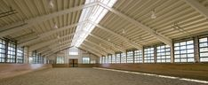"""Private Farm : Blackburn Architects, P.C. - I love the fact that the """"windows"""" on the indoor dressage arena are actually garage doors that can be raised on warmer days."""