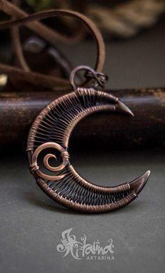 Copper crescent moon wire wrapped pendant.