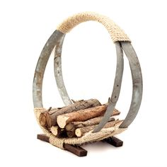 Barrel Hoop Firewood Rack made from reclaimed wine barrel hoops and staves.
