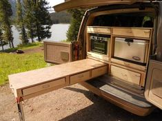 Great pullout storage which doubles as a table with collapsible leg - Chevy Astro