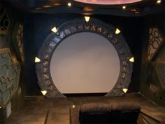 "This creative home theater features the iconic round ""Stargate"" as the frame for the screen that is 10 feet in diameter. Best Home Theater, Home Theater Rooms, Home Theater Design, Home Theater Speakers, Home Theater Projectors, Italian Home, Space Theme, Home And Deco, Home Entertainment"