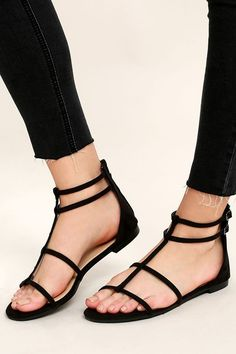 """Get ready to conquer the world in the Jayne Black Suede Gladiator Sandals! Soft vegan suede straps cross over a peep toe upper, and meet adjustable buckle straps at the outstep. 4"""" heel zipper."""