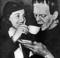 "Boris Karloff in full makeup on the set of ""Son of Frankenstein"" takes a break between shots to enjoy a cup of tea."
