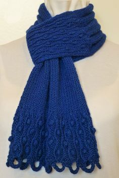 This royal blue Drifted Pearls scarf is knit in a silky-soft Merino wool and silk blend, lending a wonderful drape to this piece. The yarn has a lovely texture, much similar to the feel of chenille...