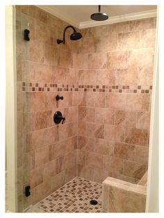 "Tile shower with bench. 9""x12"" tile used for this beige tile shower with rain head and oil rubbed bronze fixtures."