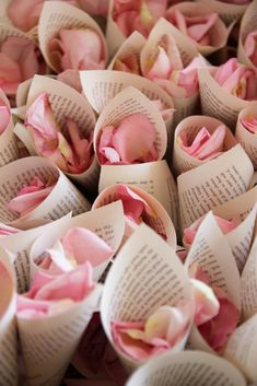 THIS WOULD BE SO PRETTY WITH SHEET MUSIC! Wrap rose petals inside your favorite quote on love or a copy of a favorite book page. Guests can throw the petals in front of the bride and groom when they leave. More
