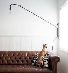 Sofá de couro com costura clássica