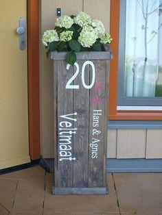 Huisnummer naambord plantenbak