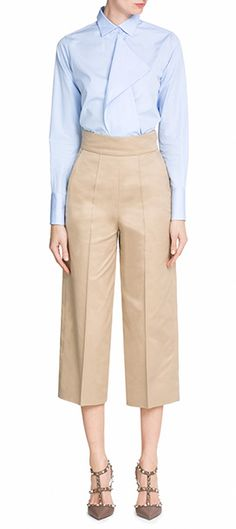 A modern alternative to the tailored trouser, Valentino's cropped chinos are designed to flatter with a high waist and crisp pleats. The camel coloring is perfect for business meetings or casual brunches #Stylebop