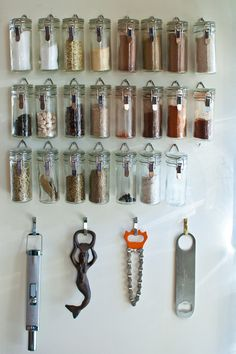 hang bottles directly on the wall with small hooks or nails