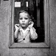 This photograph is from Vivian Maier. She at the time was an unknown street photographer. When she passed, her photographers were discovered... Wow what a street photographer.....