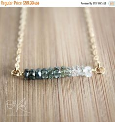 Here is a beautiful and elegant emerald green sapphire ombre necklace, set on a 16 14k gold filled chain. The chain is also available in 18 length. If you
