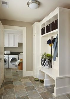 laundry room by MainStreet Design Build. Great laundry/mud room!  Love the tile!