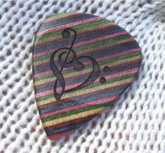 Treble and Bass Clef Heart - Custom Laser Engraved Dymondwood Handmade Premium Guitar Pick. $24.95 USD, via Etsy.