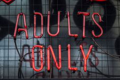 adults only neon sign at the club entrance  by IgorMadjinca   Stocksy United