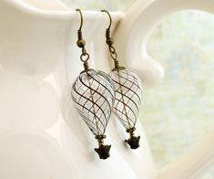 Clear Steampunk Hot air Balloon Earrings by ElainaLouiseStudios, $24.00. Gives me ideas!