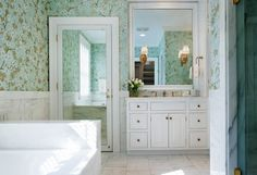 View in gallery Floral wallpaper in a crisp modern bathroom
