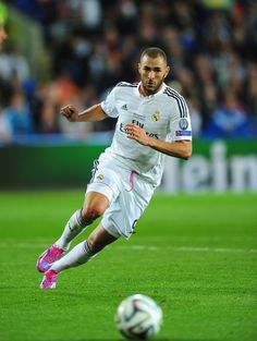 Real Madrid player Karim Benzema in action during the UEFA Super Cup match between Real Madrid and Sevilla FC at Cardiff City Stadium on August 12, 2014 in Cardiff, Wales.