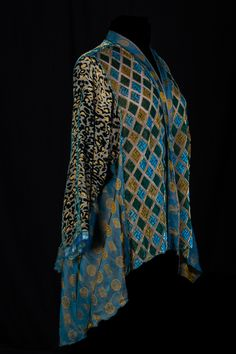 One of Rae's old favorites and an early model for the swing side jacket. The fabrics in the front, back and sleeves are burn-out silks and the side panels and band are a reversible rayon brocade, ...