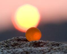 a beautiful and rare orange sea glass marble found in Washington state.