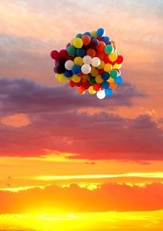 Let go of balloons and watch them disappear into the sunset