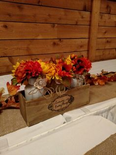 Fall flowers in small wood box for table decor