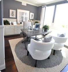 I like the medium grey walls, white shelves/cabinets and dark wood floors. Lots of white accessories to lighten and brighten the space.